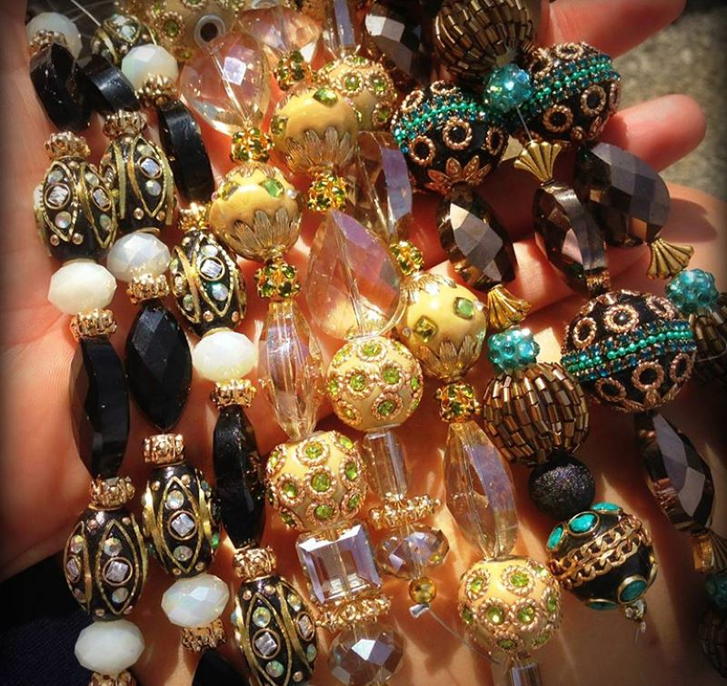 Several vibrant bead strands of various styles including crystal, metal, and boho