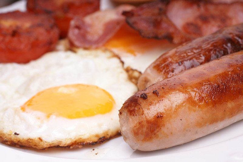 Breakfast sausages with an egg