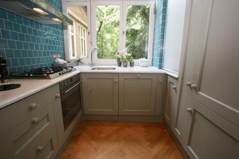 teal blue tile kitchen