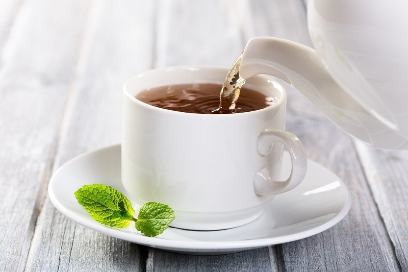 Hot tea being poured