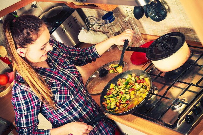 woman frying lunch