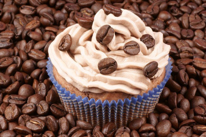 cupcake with whole coffee beans on espresso flavored frosting