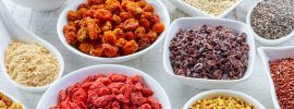 Selection of superfoods in white bowls