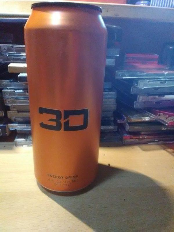 An orange can of 3D Energy Drink
