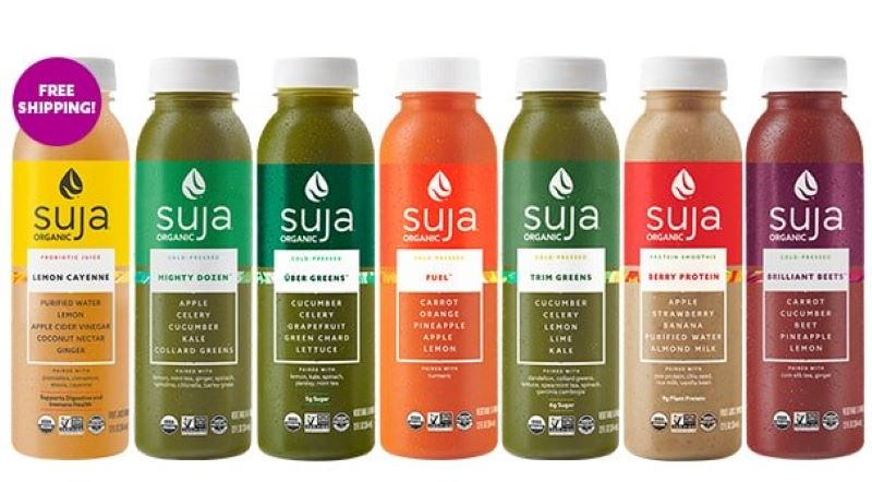7 bottles of Suja juice, from left to right Lemon Cayenne, Mighty dozen, Greens, Fuel, trim greens, berry protein, and brilliant beets