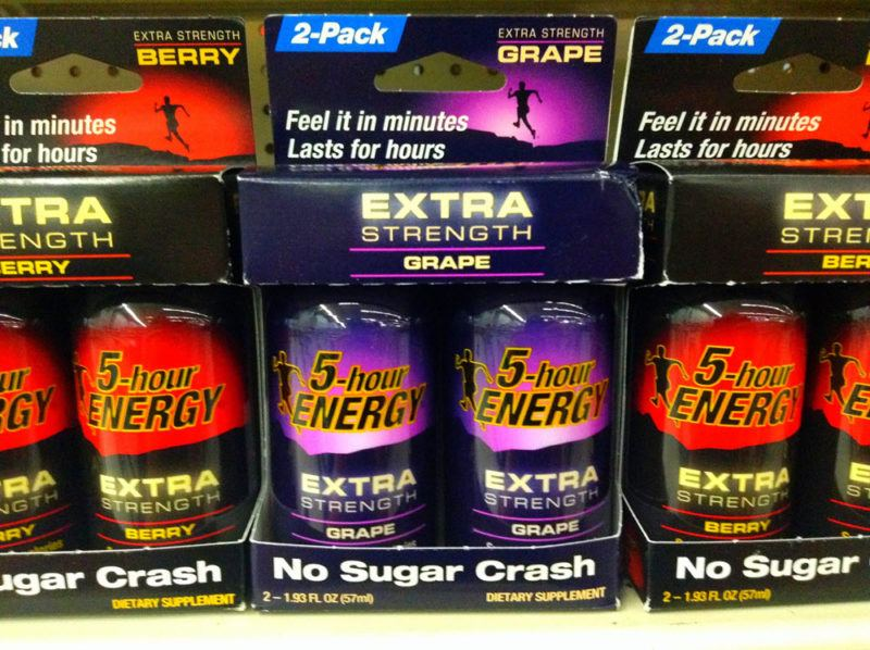 5-Hour Energy Extra Strength 2-packs on a shelf in berry and grape flavors