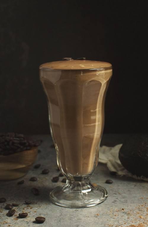 A mocha smoothie against a black background