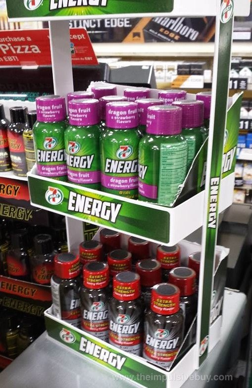 A two-tier rack of energy shots from 7-Eleven, including normal and extra strength shots