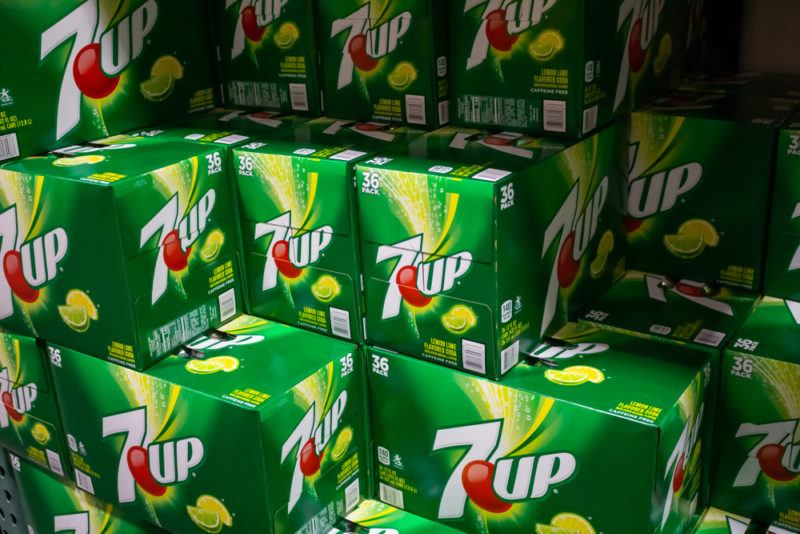 Various boxes of 7-Up in a store.