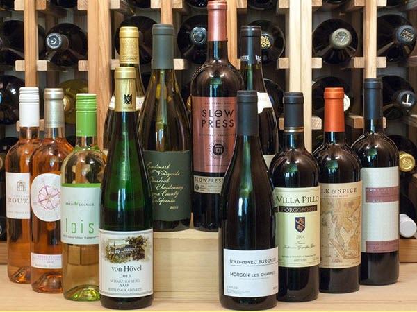12 wine bottles against a wine rack