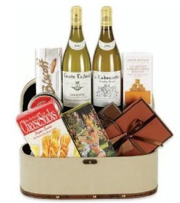 A crate with white wine and other snacks.
