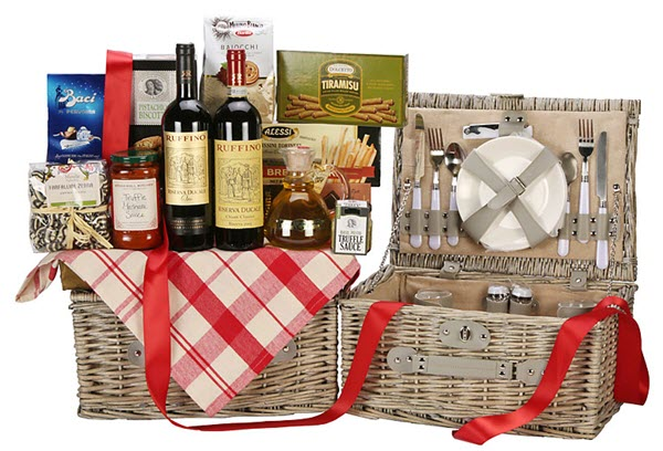 Expansive gift basket with wine, snacks and pasta sauce on the top.