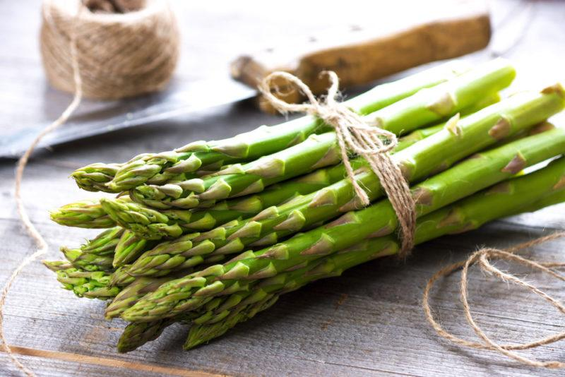 A bundle of asparagus tied with a string