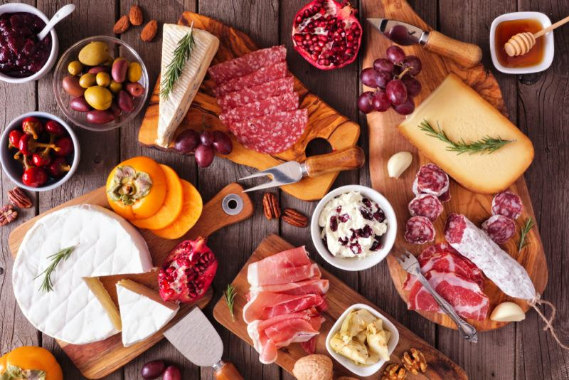 A charcuterie board with cheese and meat