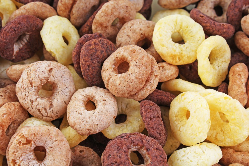 A close up image of o shaped cereal in different colors