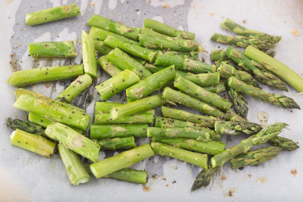 Chopped cooked asparagus on baking paper