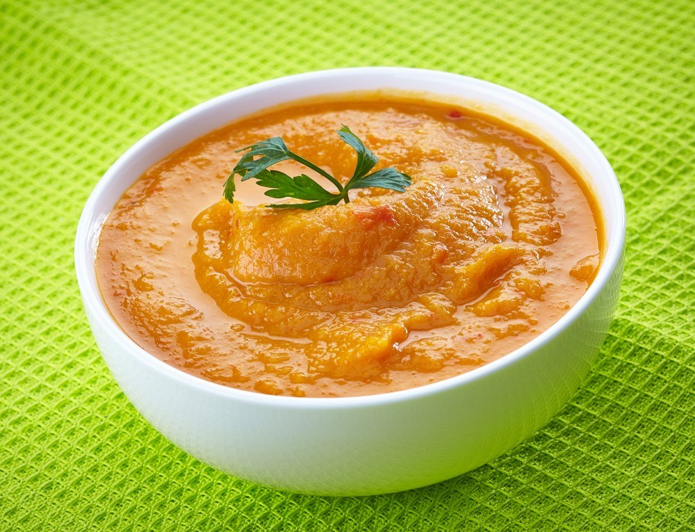 A white bowl of baby food curry