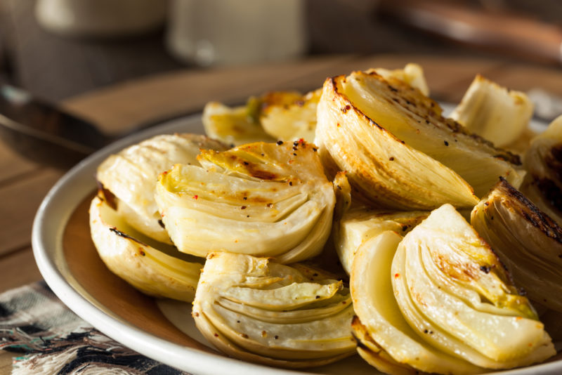 A dish of fennel pieces that have been roasted or baked