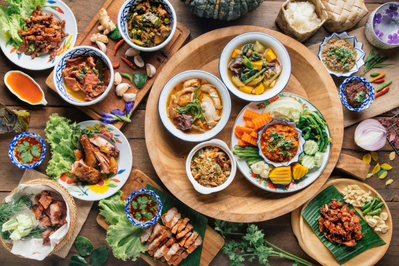 A large selection of Thai foods on a table
