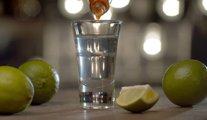 Making a shot using vodka or tequila and tabasco sauce