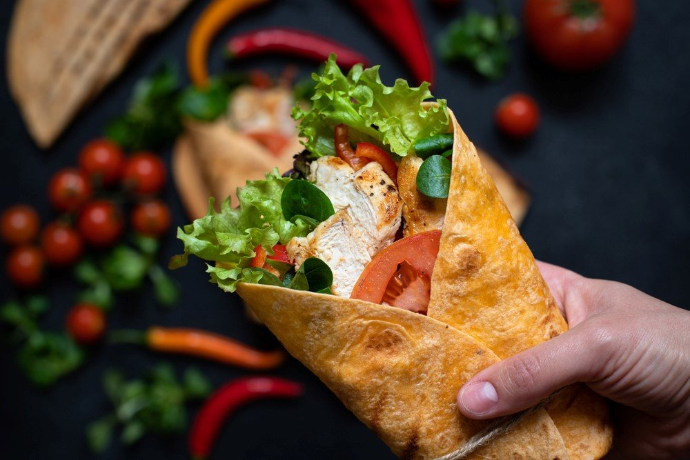 A delicious wrap made with a corn tortilla and salad