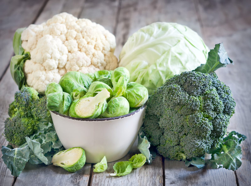 A selection of cruciferous vegetables, including cauliflower, broccoli, and brussels sprouts
