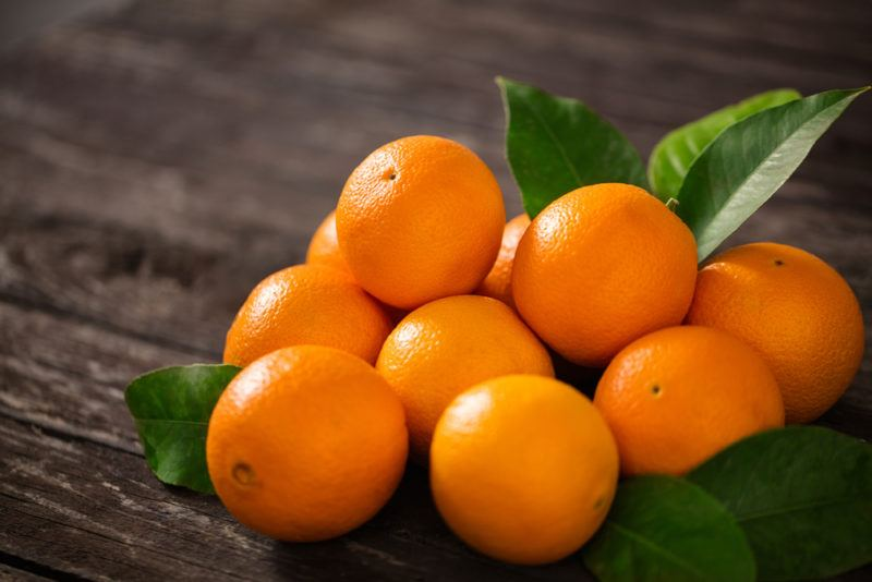 Various fresh oranges on a table