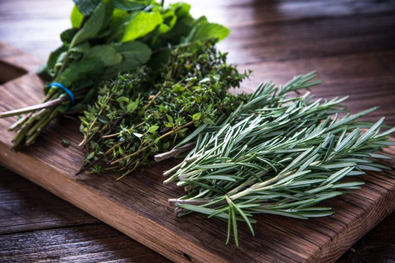 A selection of fresh herbs on a cutting board