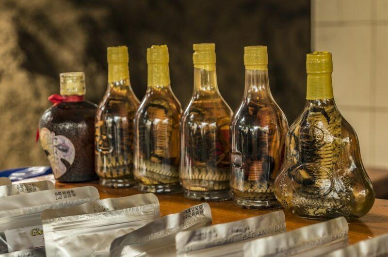 A selection of rice wine in Vietnam that includes snakes in the bottles