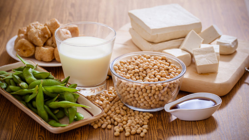 Various soy products, including soybeans, miso, edamame, soy milk, and tofu