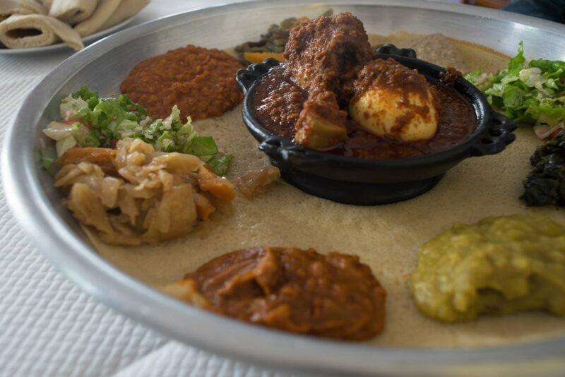 A vegetarian meal called bayenetu served on injera