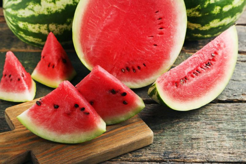 Various watermelons and watermelon pieces