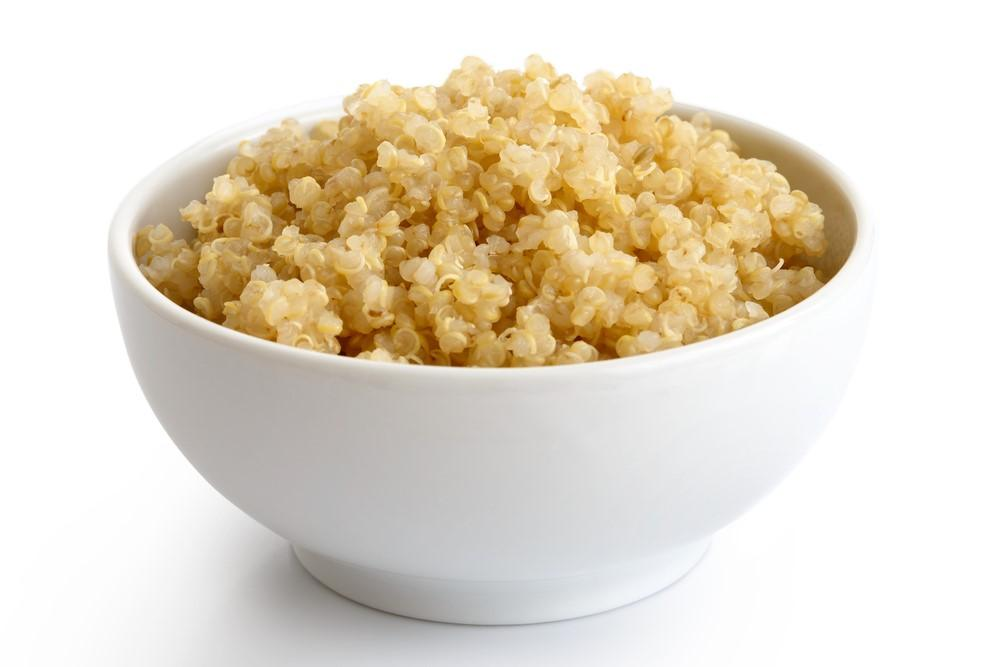 A white bowl of cooked quinoa