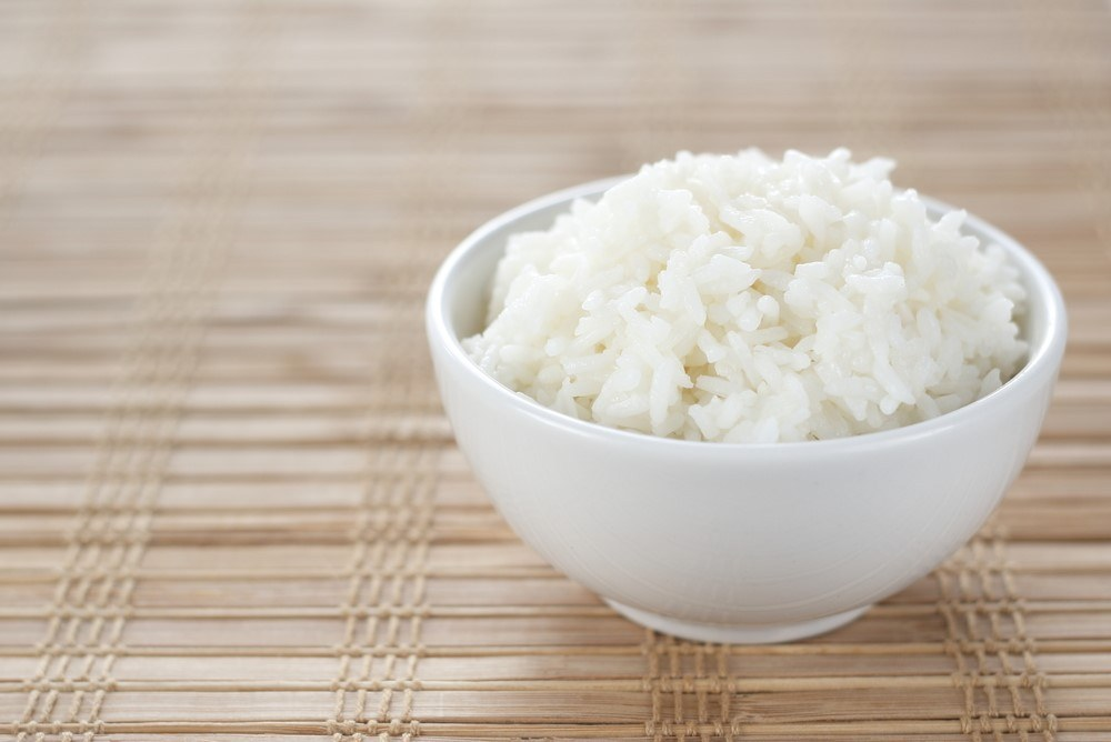 A white bowl of cooked rice
