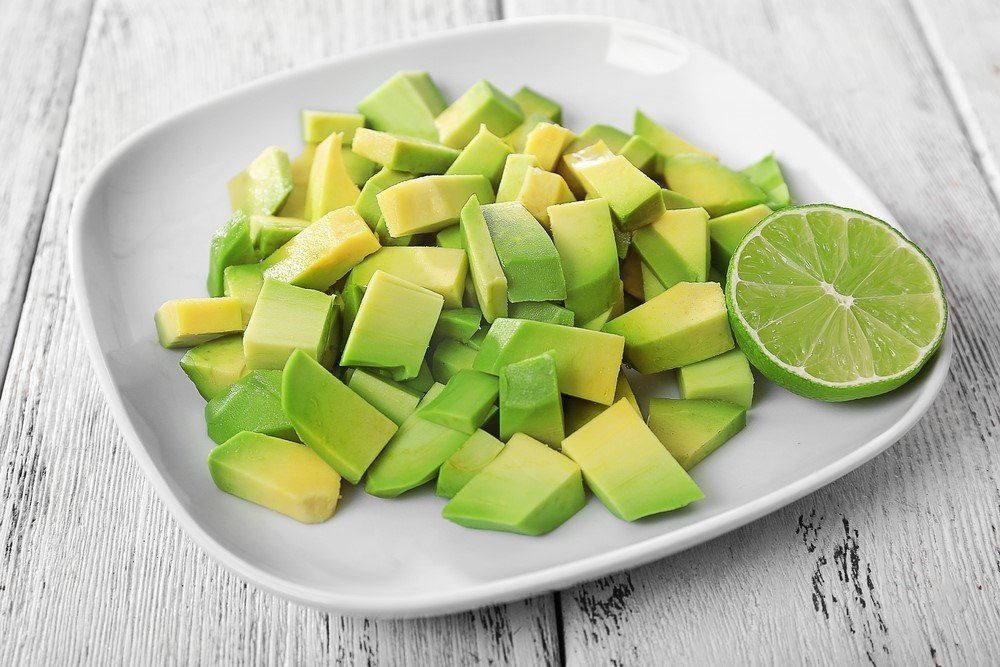 A white plate of avocado cubes