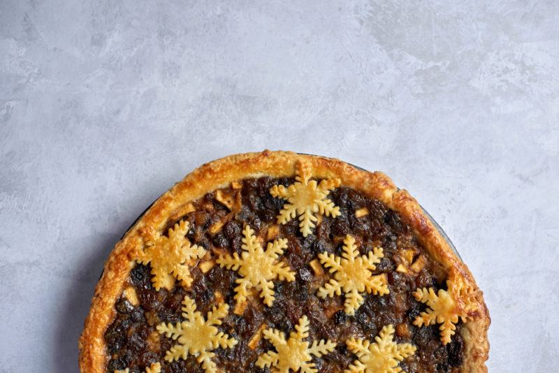 A winter fruit pie with snowflakes made out of pastry