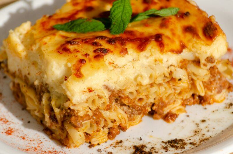 A lasagna type meal in Greece that uses ziti noodles rather than lasagna sheets and is topped with a bechamel layer