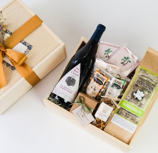 An interesting gift box with pinot noir and various snacks
