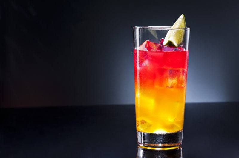 A acapulco cocktail with yellow and red tones