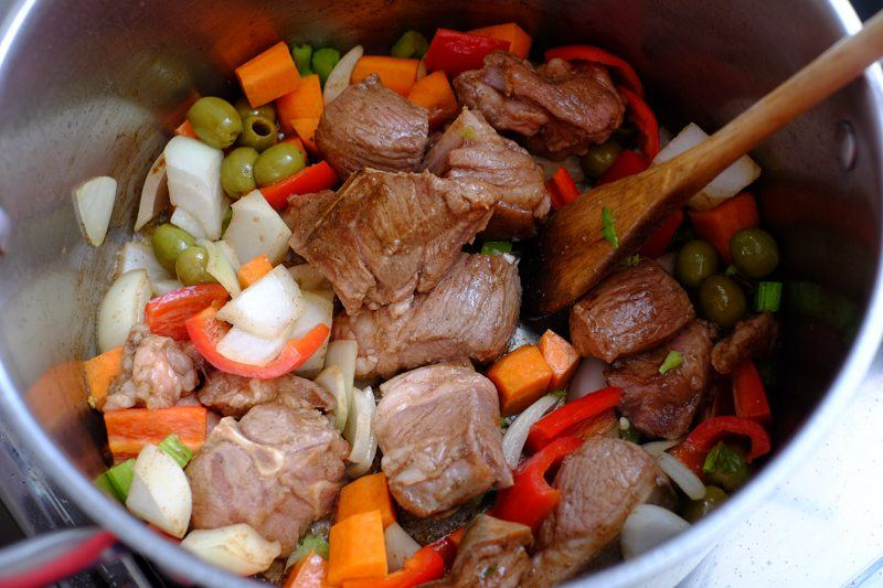 add in the onions, carrots, celery, olives, and bell peppers