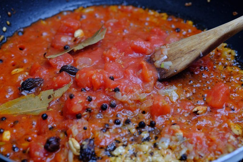 Add in the tomatoes next. Sauté them until they give off that bright red tint to your pan