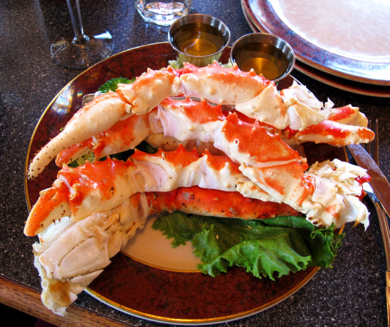 A brown plate with cooked Alaskan king crab legs