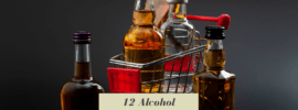 A slection of small alcohol bottles in a mini grocery cart