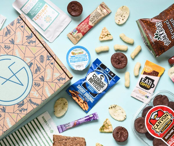 A box next to a selection of open snacks on a blue background