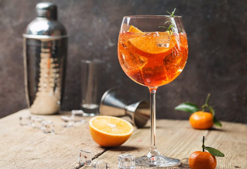 A large glass containing an aperol spritz