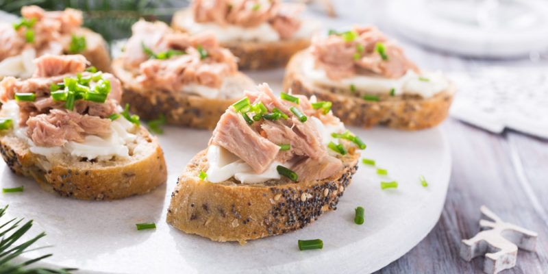 Appetizers with tuna on a white plate