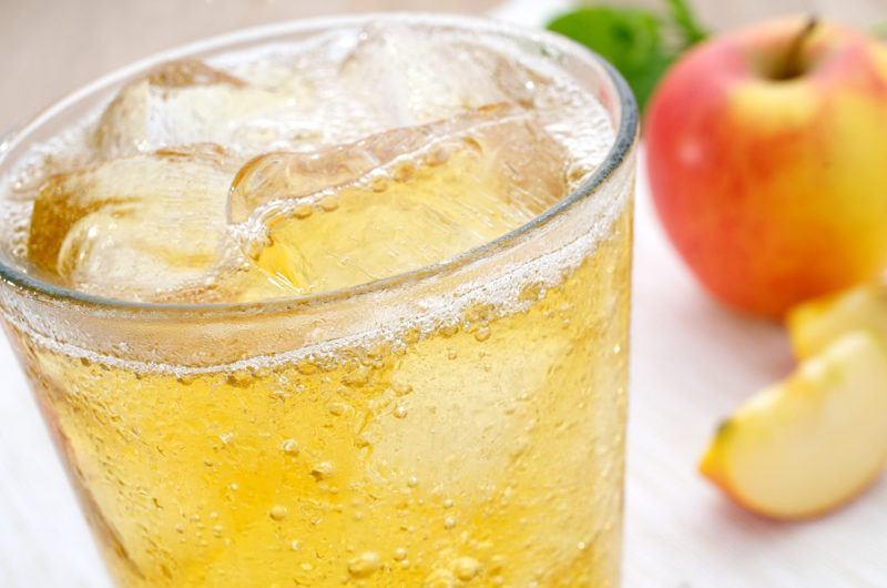 A glass of sparkling apple cider