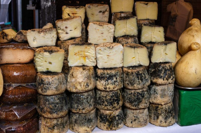 Assortment of aged cheese for sale at La Pescheria market in Catania, Italy
