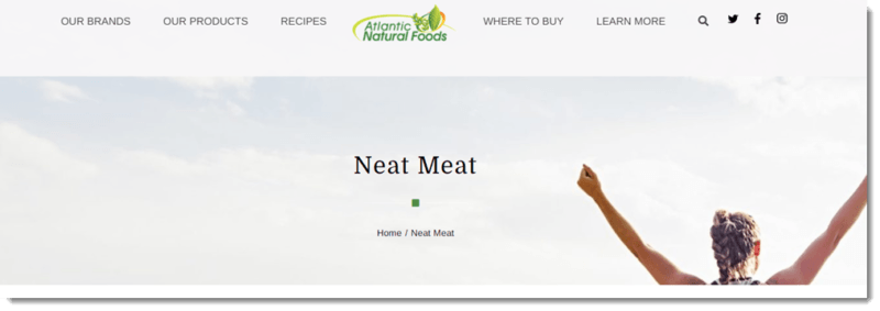 A website screenshot from the Atlantic Natural Foods site with a happy woman