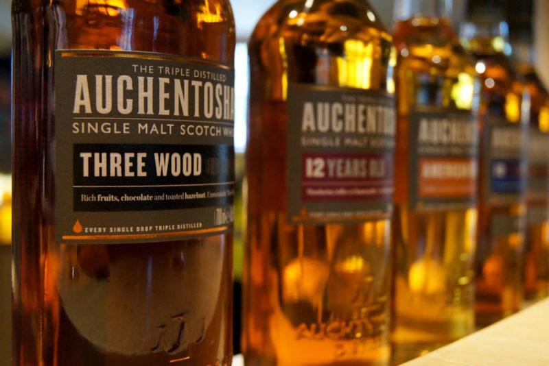 Auchentoshan single malt Scotch whisky bottles on a shelf
